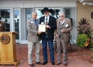 New Mexico Agriculture Secretary Jeff Witte (at left) presentsthe 2015 Rounders Award to painter Gary Morton (center) for his artistic contributions to western culture. At right is Max Evans, after whose seminal western novel The Rounders the award is named.