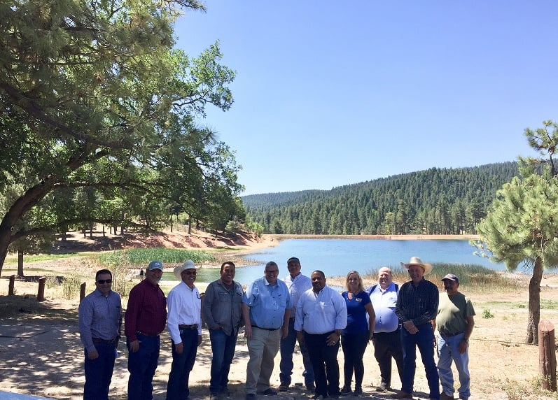 United States Department of Agriculture Under Secretary of Farm Production and Conservation Bill Northey (fifth from left), along with members of the Mescalero Apache Tribe, USDA Natural Resource Conservation Service, Farm Service Agency and New Mexico Association of Conservation Districts, visited Silver Lake June 11 to observe progress made on forest management and conservation projects.