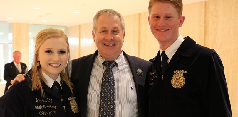 Jeff Witte and two young adults pose together. The younger people work for FFA and are in their uniforms
