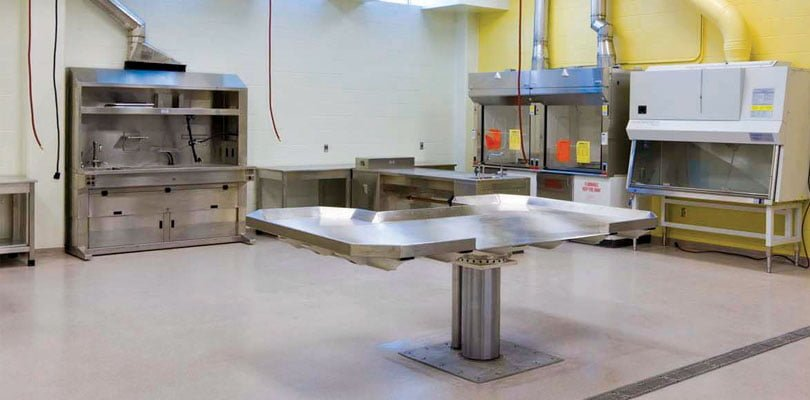 A lab table is shown in the center of a room with all sorts of equipment. The room is located in at the Veterinary Diagnostics Lab.