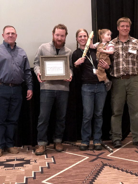 New Mexico Department of Agriculture Organic Program Supervisor Stacy Gerk (left) and Walking Trout Farm's Joseph Marcoline (right) presented one of two Organic Farming Conference Educator of the Year Awards to Mary Lucero (center) at the 2019 New Mexico Organic Farming Conference Feb. 15-16 in Albuquerque. (Photo by Erin Roy)
