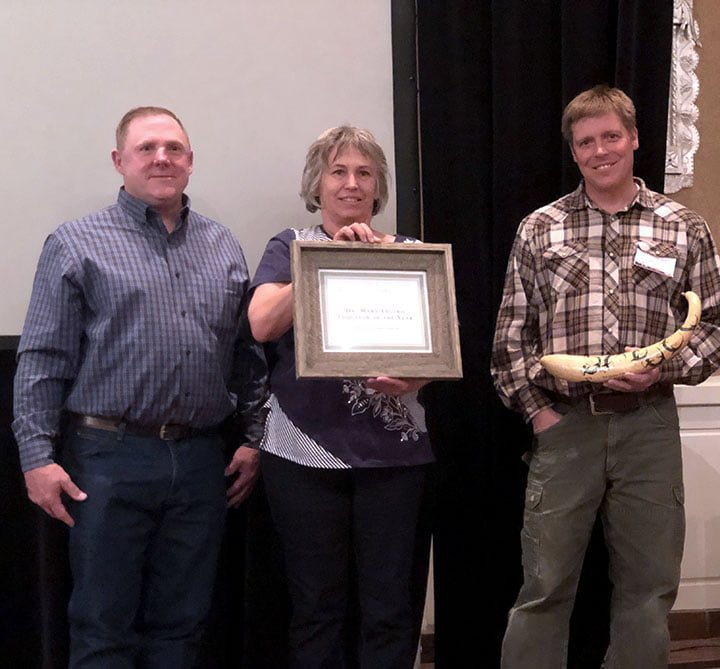 New Mexico Department of Agriculture Organic Program supervisor Stacy Gerk (left) and Walking Trout Farm's Joseph Marcoline (right) presented one of two Organic Farming Conference Educator of the Year Awards to Zach and Jasmine Cecelic (center) at the 2019 New Mexico Organic Farming Conference Feb. 15-16 in Albuquerque. (Photo by Erin Roy)