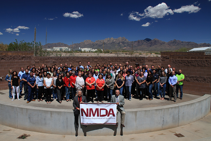 NMDA is made up of many individuals, each with their own unique skills. The employees are seen posing for a photo with the Oregon Mountains rising up in the background