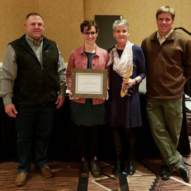 New Mexico Department of Agriculture Organic Program Supervisor Stacy Gerk (left) and Walking Trout Farm's Joseph Marcoline (right) presented one of three Friend of Organic Agriculture Awards to Rachel and Nancy Langer from Red Rock Roasters at the 2020 New Mexico Organic Farming Conference Feb. 21-22 in Albuquerque.
