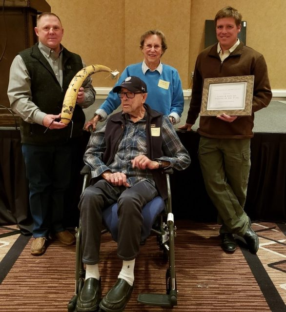 New Mexico Department of Agriculture Organic Program Supervisor Stacy Gerk (left) and Walking Trout Farm's Joseph Marcoline (right) presented the Organic Farmer of the Year Award to Ron and Gayle Ice at the 2020 New Mexico Organic Farming Conference Feb. 21-22 in Albuquerque.