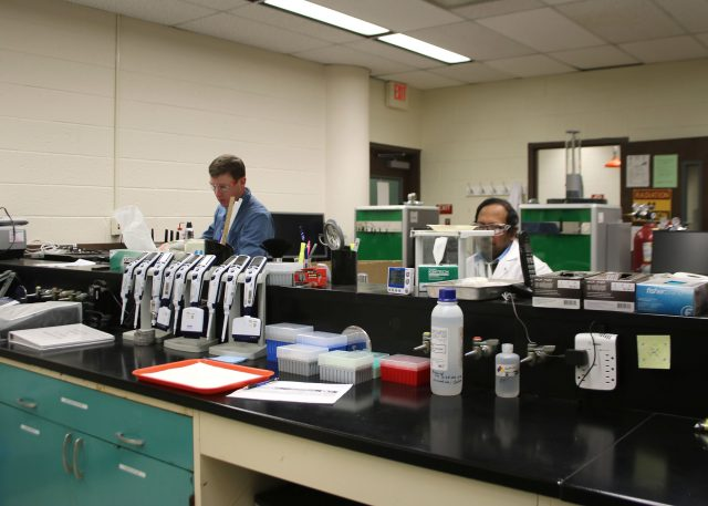 State chemist Stephen Lantz (left) and chemist Shahiduz Zaman (right) conduct testing at the New Mexico Department of Agriculture's State Chemist Laboratory in Las Cruces. The lab recently became an International Organization for Standardization 17025: 2017 accredited laboratory, within a scope that includes chemical and biological methods for testing animal feed.