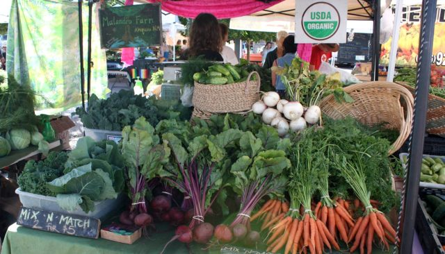 Fresh vegetables at a farmers market stand