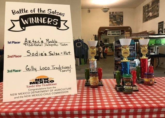 Battle of the Salsas top 3 winners displayed with their trophies