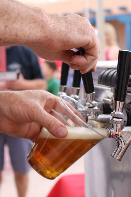 A beer being poured from tap